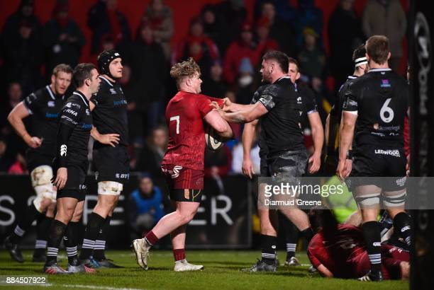 Cork Ireland 2 December 2017 Chris Cloete of Munster and Gareth Thomas of Ospreys tussle off the ball during the Guinness PRO14 Round 10 match...
