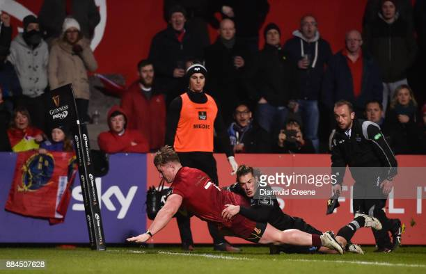 Cork Ireland 2 December 2017 Chris Cloete of Munster scores his side's third try despite the efforts of Jeff Hassler of Ospreys during the Guinness...