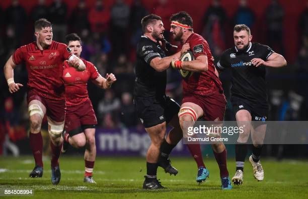Cork Ireland 2 December 2017 Jean Kleyn of Munster is tackled by Gareth Thomas of Ospreys during the Guinness PRO14 Round 10 match between Munster...