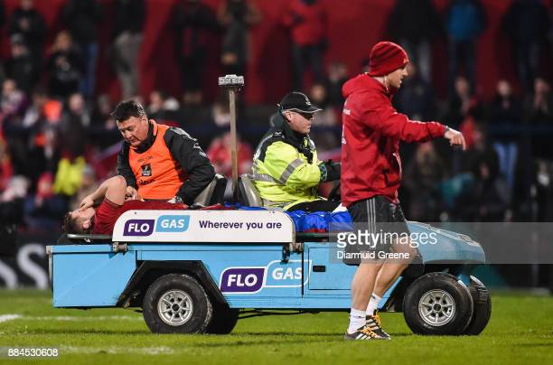 Cork Ireland 2 December 2017 Liam OConnor of Munster accompanied by Dr Tadhg O'Sullivan is stretchered off after picking up an injury during the...