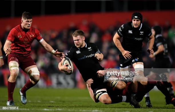Cork Ireland 2 December 2017 Olly Cracknell of Ospreys is tackled by John Ryan of Munster during the Guinness PRO14 Round 10 match between Munster...