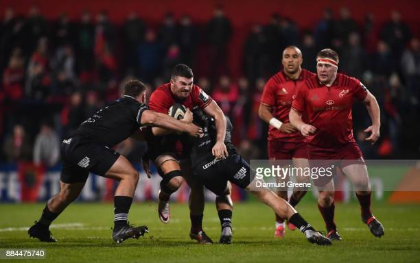 Cork Ireland 2 December 2017 Sam Arnold of Munster is tackled by Gareth Thomas left and Kieron Fonotia of Ospreys during the Guinness PRO14 Round 10...