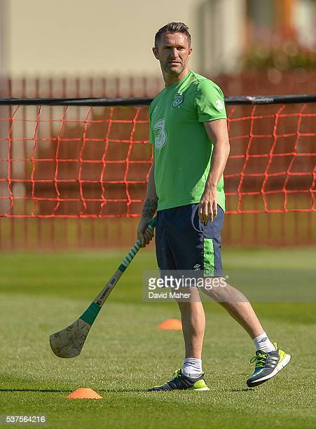 Cork Ireland 2 June 2016 Robbie Keane of Republic of Ireland holding a hurley during squad training in Fota Island Resort Fota Island Cork