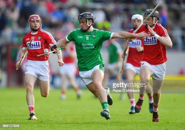 Cork Ireland 2 June 2018 Darragh ODonovan of Limerick in action against Daniel Kearney left and Darragh Fitzgibbon of Cork during the Munster GAA...