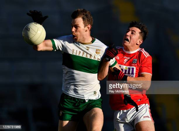 Cork , Ireland - 22 November 2020; Liam Casey of Tipperary is tackled by Tadhg Corkery of Cork during the Munster GAA Football Senior Championship...