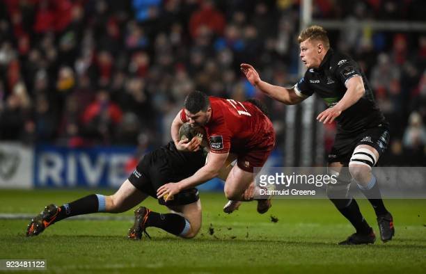 Cork Ireland 23 February 2018 Sam Arnold of Munster is tackled by James Malcolm left and Matt Smith of Glasgow Warriors during the Guinness PRO14...