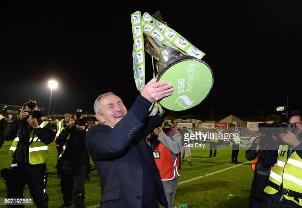 Cork , Ireland - 27 October 2017; Cork City manager John Caulfield celebrates with the SSE Airtricity League Premier Division trophy after the SSE...