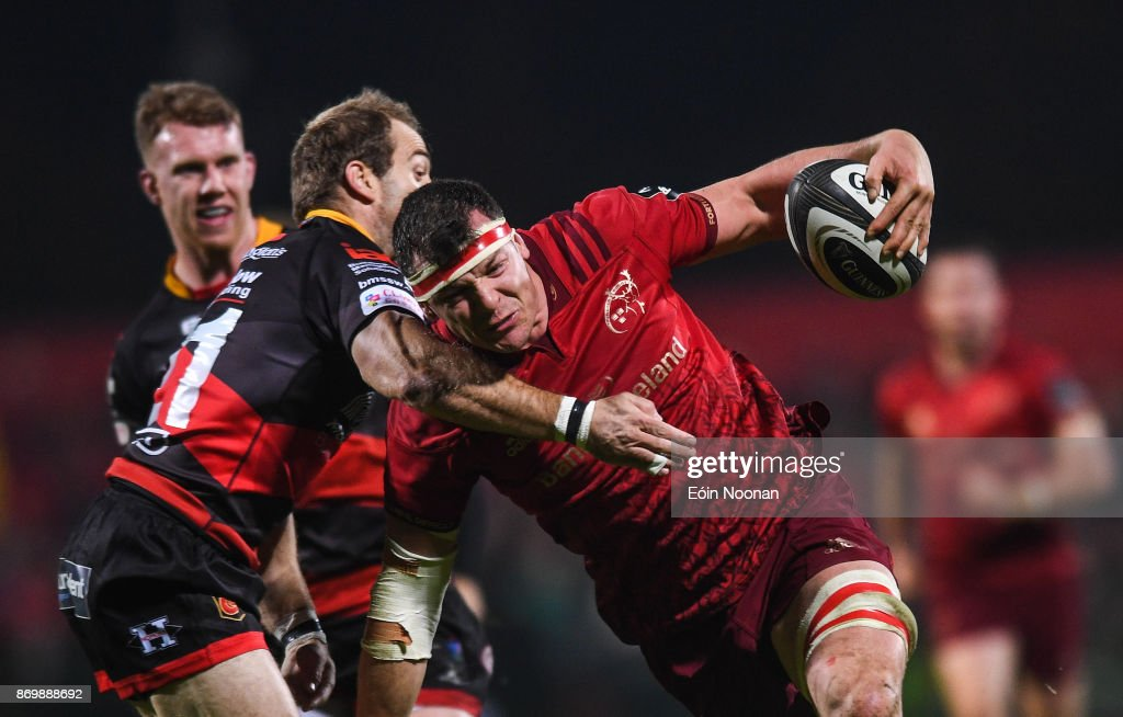 Cork , Ireland - 3 November 2017; Robin Copeland of Munster is tackled by Sarel Pretorius of Dragons during the Guinness PRO14 Round 8 match between Munster and Dragons at Irish Independent Park in Cork.