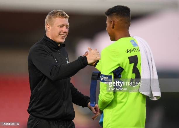 Cork Ireland 6 July 2018 Gavin Bazunu of Shamrock Rovers is congratulated by Kevin Horgan following the SSE Airtricity League Premier Division match...