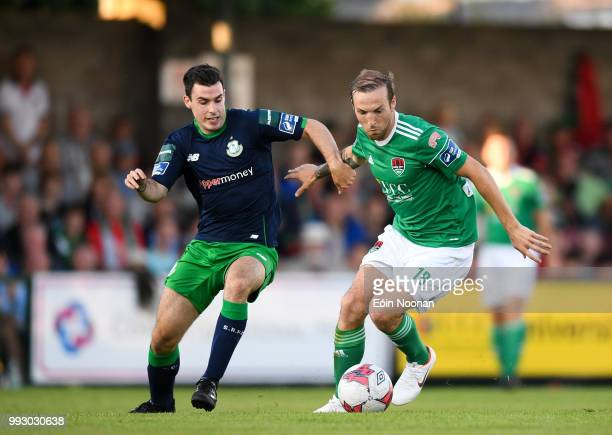 Cork Ireland 6 July 2018 Karl Sheppard of Cork City in action against Joel Coustrain of Shamrock Rovers during the SSE Airtricity League Premier...