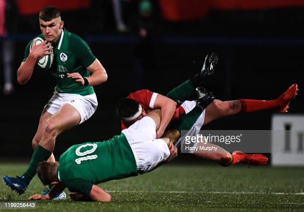 Cork Ireland 7 February 2020 Ben Moxham of Ireland receives the ball as Jack Crowley of Ireland is tackled by Dafydd Buckland of Wales during the U20...