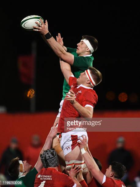Cork Ireland 7 February 2020 Thomas Ahern of Ireland wins possession in a lineout ahead of Ben Carter of Wales during the U20 Six Nations Rugby...