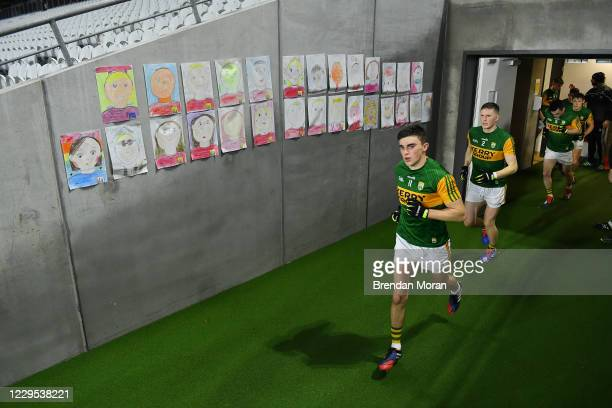Cork , Ireland - 8 November 2020; Kerry players, Seán OShea, Jason Foley and Paul Murphy run out of the players tunnel past portraits by Cork...