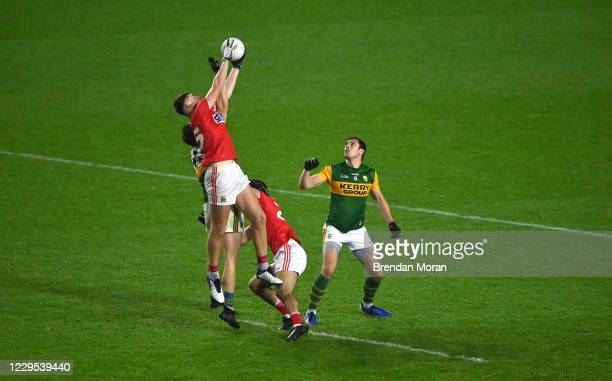 Cork , Ireland - 8 November 2020; Mark Keane of Cork catches the throw in for extra time ahead of Jack Barry and David Moran of Kerry during the...