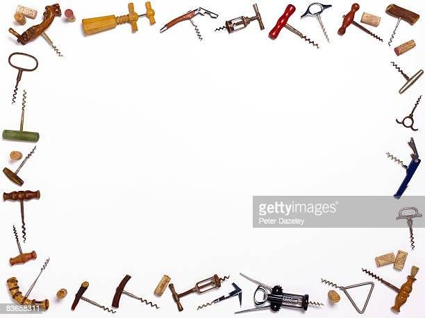 Cork screws on white background with corks.