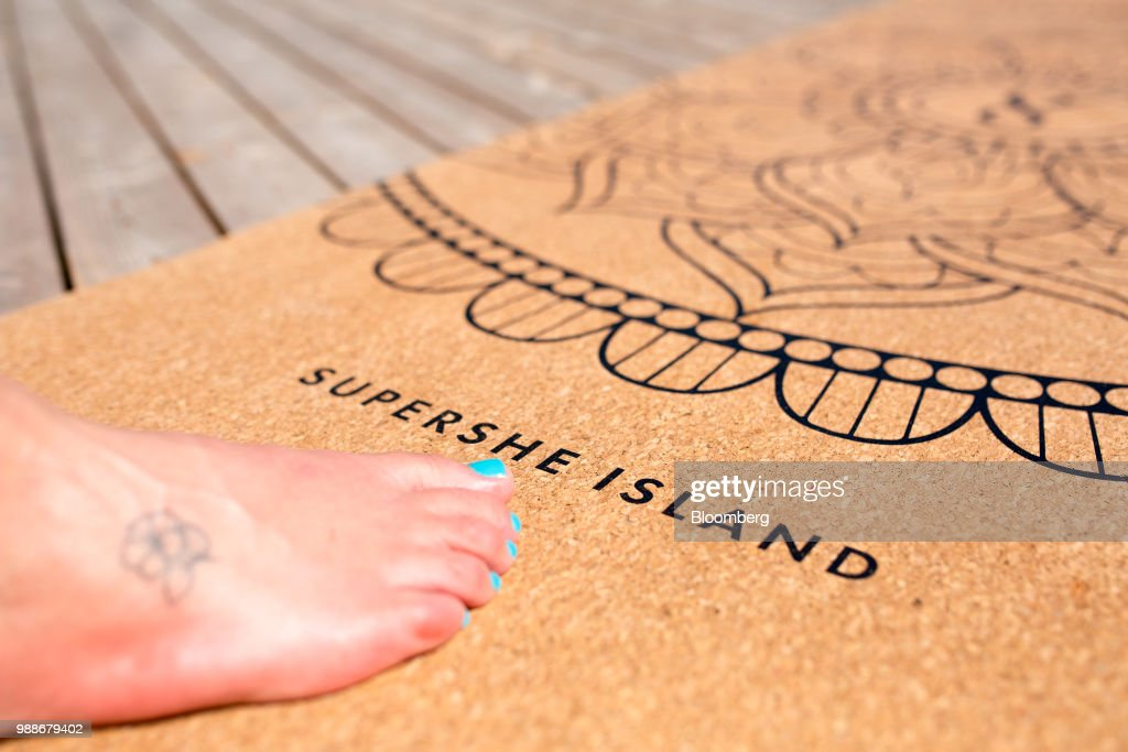 A cork yoga mat embellished with the SuperShe island name lies on a terrace on SuperShe island near Raasepori, Finland, on Wednesday, June 27, 2018. The price of experimental networking on the island that has banned men, and only accepts heavily vetted women, is 4,000 euros, or $4,600. The package includes self-help tools that can lead participants down a different career path, as well as cognitive training to expel any negative thoughts. Photographer: Heli Blafield/Bloomberg via Getty Images