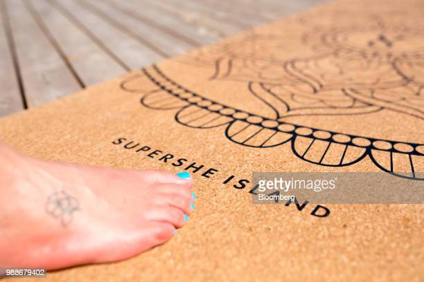 Cork yoga mat embellished with the SuperShe island name lies on a terrace on SuperShe island near Raasepori, Finland, on Wednesday, June 27, 2018....