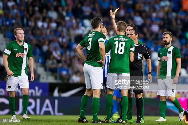 Cork's Alan Bennett receives a yellow card from referee Clayton Pisani during the UEFA Europa League football match between Belgium's RC Genk and...
