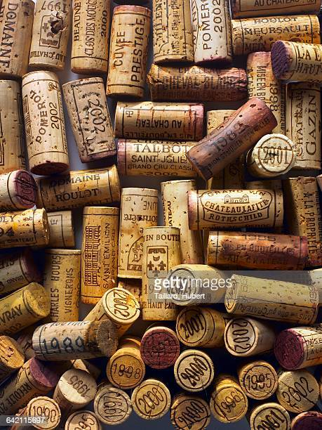 corks from bottles of vintage wine - cork stopper stock pictures, royalty-free photos & images