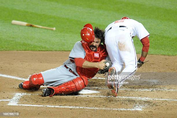 Corky Miller of the Cincinnati Reds tags out Denard Span of the Washington Nationals at the plate during a baseball game against the Cincinnati Reds...