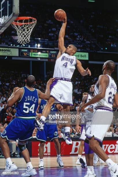 Corlis Williamson of the Sacramento Kings dunks circa 1996 at Arco Arena in Sacramento California NOTE TO USER User expressly acknowledges and agrees...