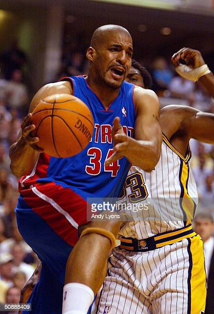 Corliss Williamson of the Detroit Pistons is put under pressure by Ron Artest of the Indiana Pacers in Game one of the Eastern Conference Finals...