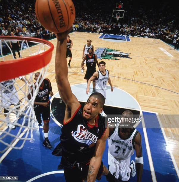 Corliss Williamson of the Philadelphia 76ers takes the ball to the basket during a game against the Minnesota Timberwolves at Target Center on...