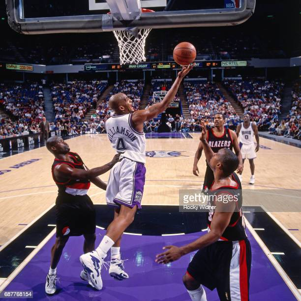 Corliss Williamson of the Sacramento Kings shoots against the Portland Trail Blazers circa 1996 at Arco Arena in Sacramento California NOTE TO USER...