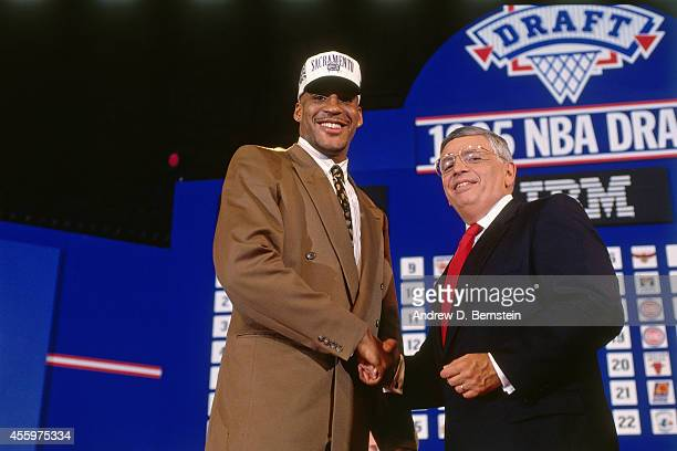 Corliss Williamson shakes hands with NBA Commissioner David Stern after he was selected number thirteen overall by the Sacramento Kingsduring the...
