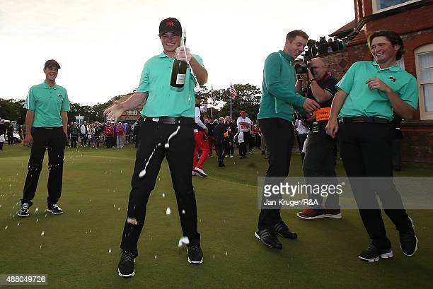 Cormac Sharvin of Great Britain Ireland and his teammates celebrate with champagne following the Sunday Singles on Day Two of the 2015 Walker Cup at...