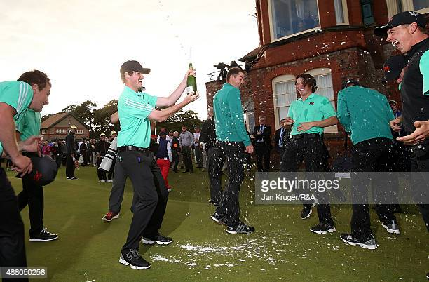 Cormac Sharvin of Great Britain Ireland and his teammates celebrate following the Sunday Singles on Day Two of the 2015 Walker Cup at Royal Lytham St...