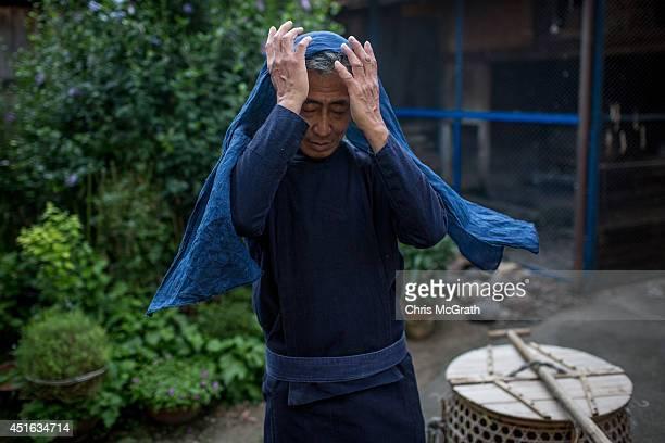 Cormorant master, Mr. Masahiko Sugiyama puts on his traditional Kazori-Eboshi in preparation for the nights Ukai on July 2, 2014 in Gifu, Japan. In...