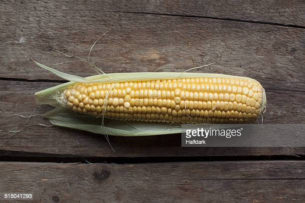 Corn cob on wooden table