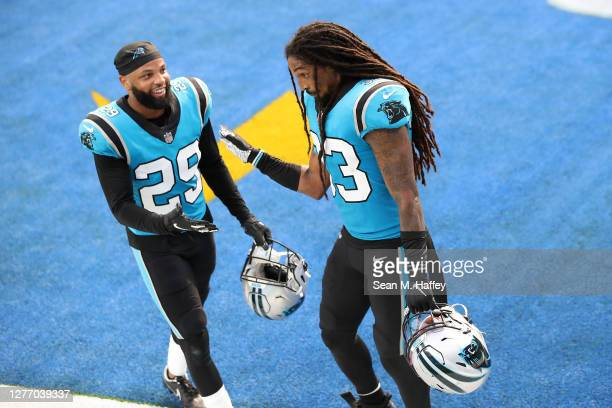 Corn Elder and Tre Boston of the Carolina Panthers celebrate defeating the Los Angeles Chargers 21-16 in a game at SoFi Stadium on September 27, 2020...