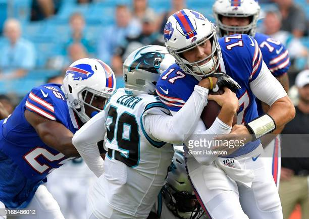 Corn Elder of the Carolina Panthers sacks Josh Allen of the Buffalo Bills during the first quarter of their preseason game at Bank of America Stadium...