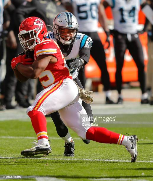 Corn Elder of the Carolina Panthers tackles Clyde Edwards-Helaire of the Kansas City Chiefs on a first quarter run at Arrowhead Stadium on November...