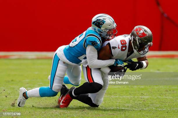 Corn Elder of the Carolina Panthers tackles O.J. Howard of the Tampa Bay Buccaneers during the first half at Raymond James Stadium on September 20,...
