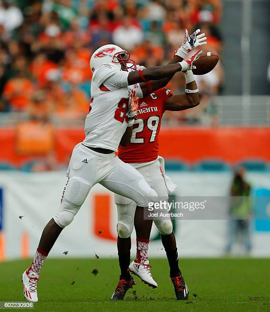 Corn Elder of the Miami Hurricanes break up the pass intended for John Mitchell of the Florida Atlantic Owls on September 10, 2016 at Hard Rock...