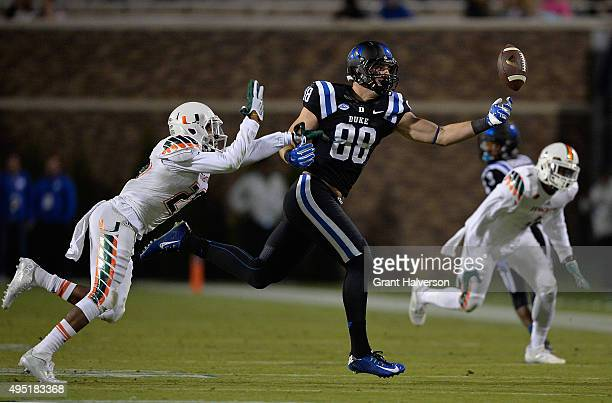 Corn Elder of the Miami Hurricanes defends a pass to Erich Schneider of the Duke Blue Devils during their game at Wallace Wade Stadium on October 31,...