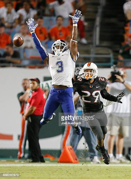 Corn Elder of the Miami Hurricanes defends as Jamison Crowder of the Duke Blue Devils is unable to catch the ball on September 27 2014 at Sun Life...