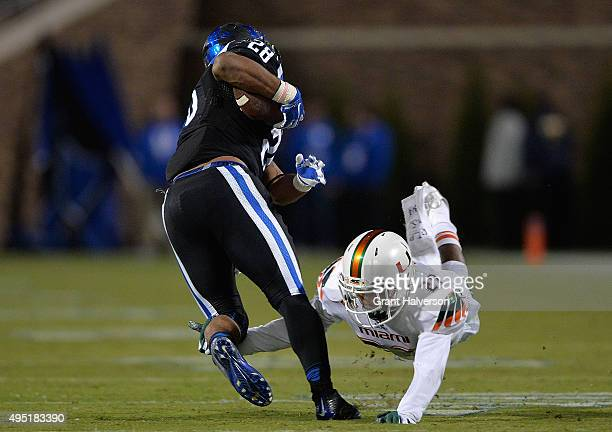 Corn Elder of the Miami Hurricanes dives to tackle Jela Duncan of the Duke Blue Devils during their game at Wallace Wade Stadium on October 31, 2015...