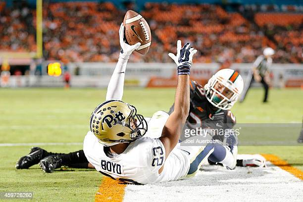 Corn Elder of the Miami Hurricanes looks back as Tyler Boyd of the Pittsburgh Panthers hold the ball up in the air, but the pass in the end zone was...