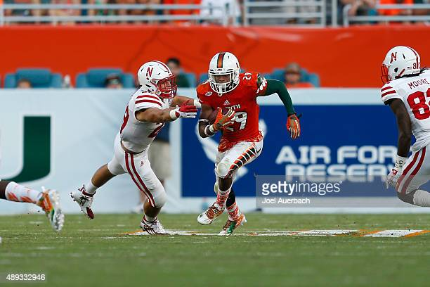 Corn Elder of the Miami Hurricanes returns a punt against the Nebraska Cornhuskers on September 19, 2015 at Sun Life Stadium in Miami Gardens,...