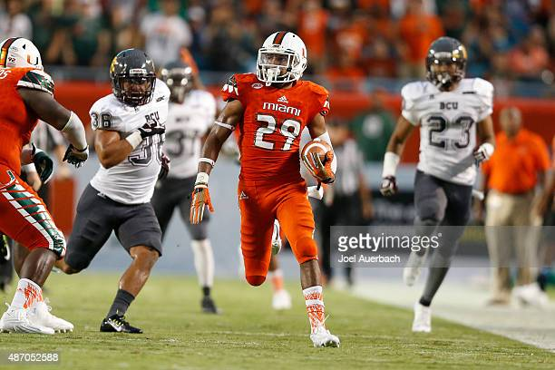 Corn Elder of the Miami Hurricanes runs the punt back against the Bethune-Cookman Wildcats on September 5, 2015 at Sun Life Stadium in Miami Gardens,...