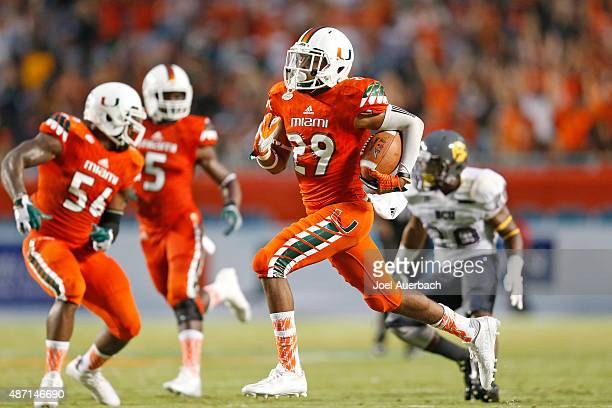 Corn Elder of the Miami Hurricanes runs with the ball against the Bethune-Cookman Wildcats on September 5, 2015 at Sun Life Stadium in Miami Gardens,...