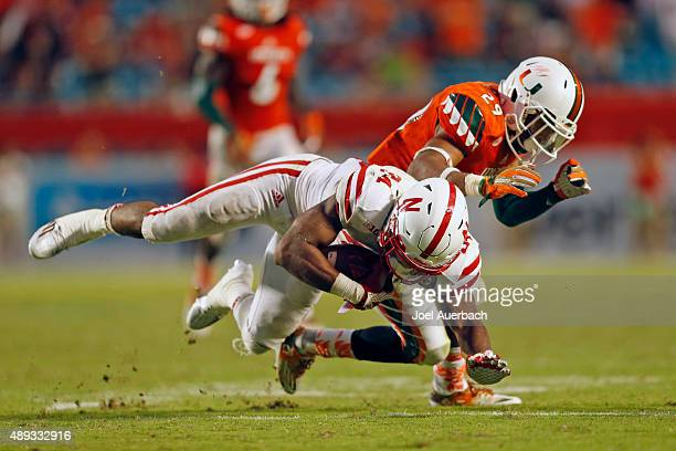 Corn Elder of the Miami Hurricanes tackles Terrell Newby of the Nebraska Cornhuskers on September 19, 2015 at Sun Life Stadium in Miami Gardens,...