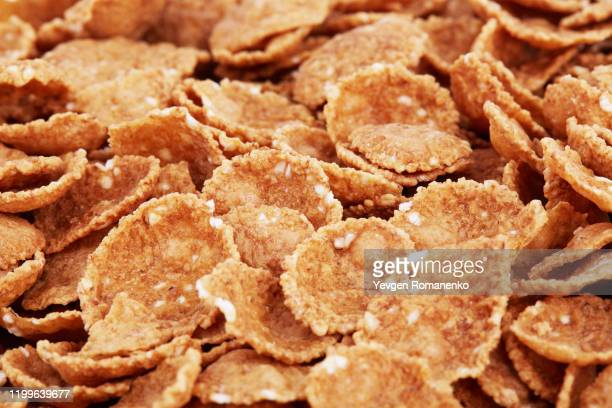 corn flakes background and texture. food background, top view - 穀草 ストックフォトと画像