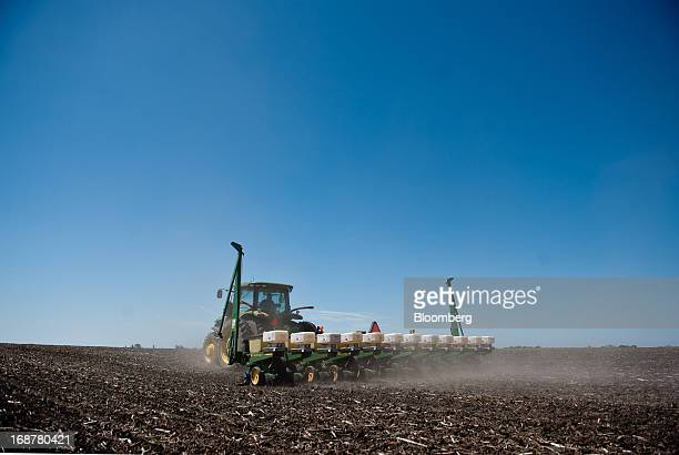 Corn is planted in a field outside of Henry Illinois US on Tuesday May 14 2013 Corn and soybeans fell Wednesday for a second day in Chicago on...