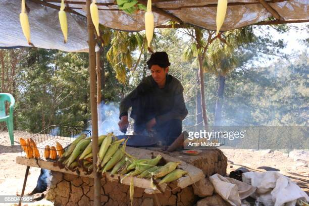corn seller - pakistani boys stock photos and pictures