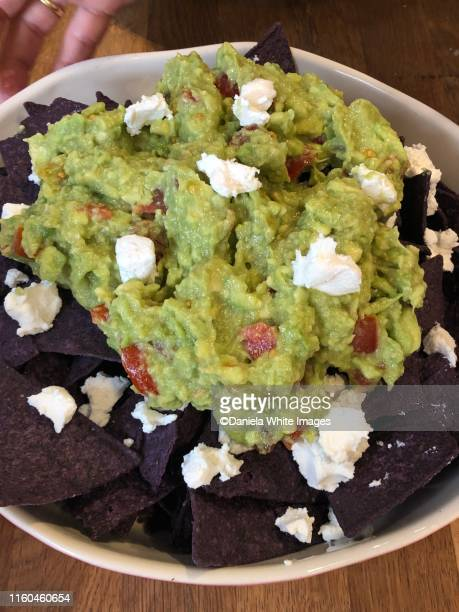 corn tortilla chips and guacamole - guacamole stock pictures, royalty-free photos & images